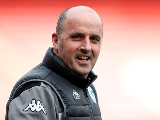 Paul Cook hails Wigan as they move five points clear at League One summit