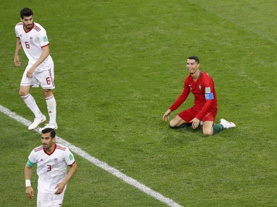 Portugal limp into the last 16 with draw against Iran