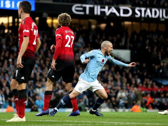 Manchester City 3 - 1 Manchester United: City move 12 points ahead of United after hard-fought Manchester derby triumph