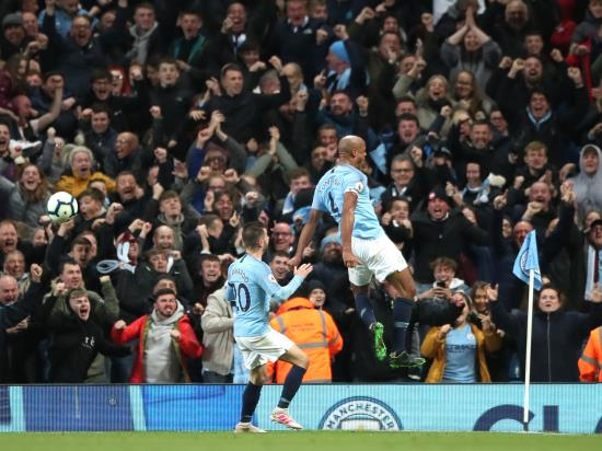 Captain Kompany leads by example as City regain top spot