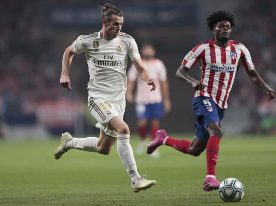Atletico and Real share spoils in Madrid derby stalemate