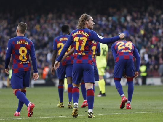 Barcelona edge past gutsy Getafe to pile pressure on Real Madrid