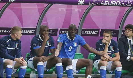 UEFA launch inquiry into monkey chants aimed at Italy striker Balotelli
