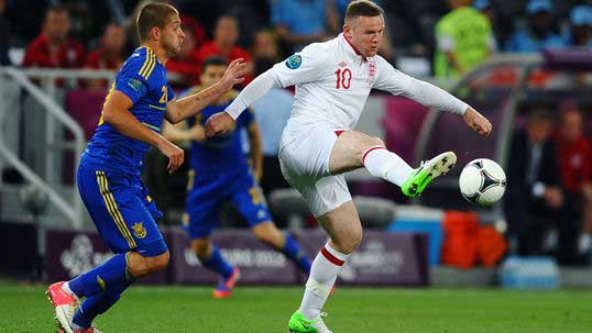 Returning Rooney fires England top