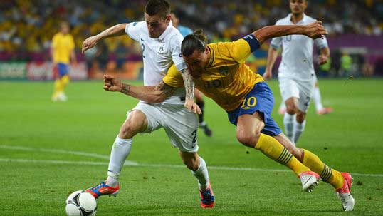 France through despite Swede defeat