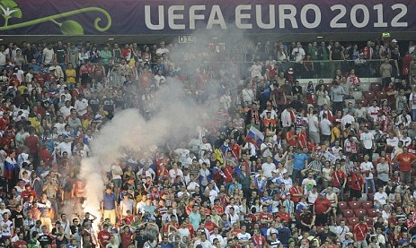 Russia hit by £28,000 UEFA fine after fans display illicit banners and lob fireworks in Greece loss