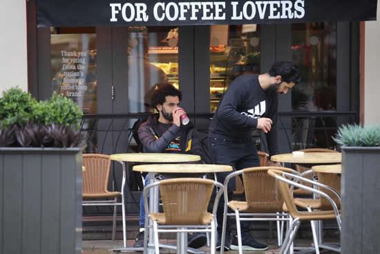 Manchester City star Sergio Aguero heads out for lunch while Liverpool's Mohamed Salah goes for coffee up the road in Cheshire