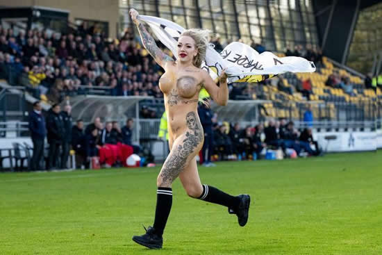 Dutch football fans hire busty tattooed STRIPPER to invade pitch wearing nothing more than body paint