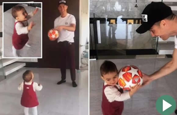 Cristiano Ronaldo's cute baby daughter runs off with his hat-trick ball