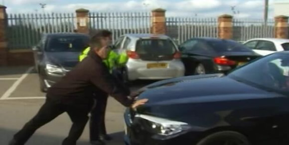 Police physically stop Joey Barton leaving ground after he is accused of assaulting Barnsley manager in post-match brawl
