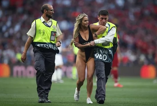 VIVA LA VITA Sexy female pitch invader at Champions League final promoting X-rated PORN site Vitaly Uncensored which vows 'wild pranks, t*** and a**, no rules'