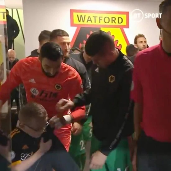 Wolves keeper Rui Patricio wraps shivering young mascot in his coat before Watford loss