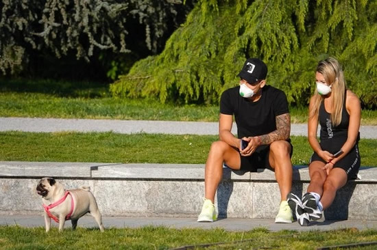 Barcelona transfer target Lautaro Martinez and stunning Wag Agustina Gandolfo wear masks to take dog for walk in Milan
