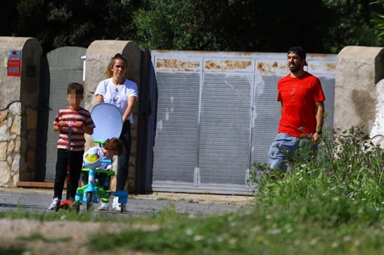 Luis Suarez seen for first time in six weeks during walk with family as Barcelona 'put striker on transfer list'