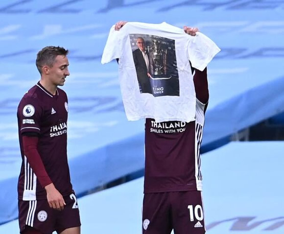 Maddison holds up T-shirt to honour late Leicester club doctor who died this summer after stunning strike at Man City