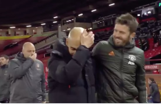 Michael Carrick and Pep Guardiola's intense chat after Manchester derby confuses fans
